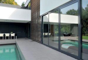 swimming pool patio area with patio doors
