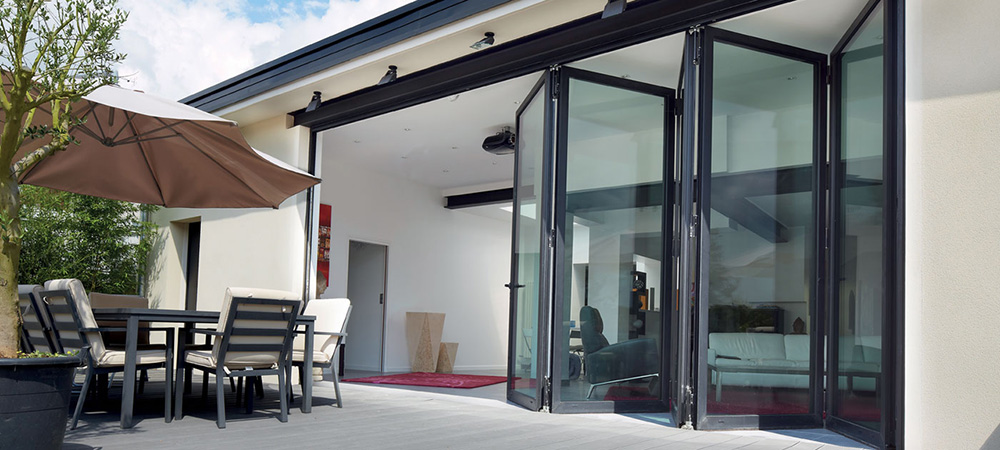 outside decking area in front of open patio doors