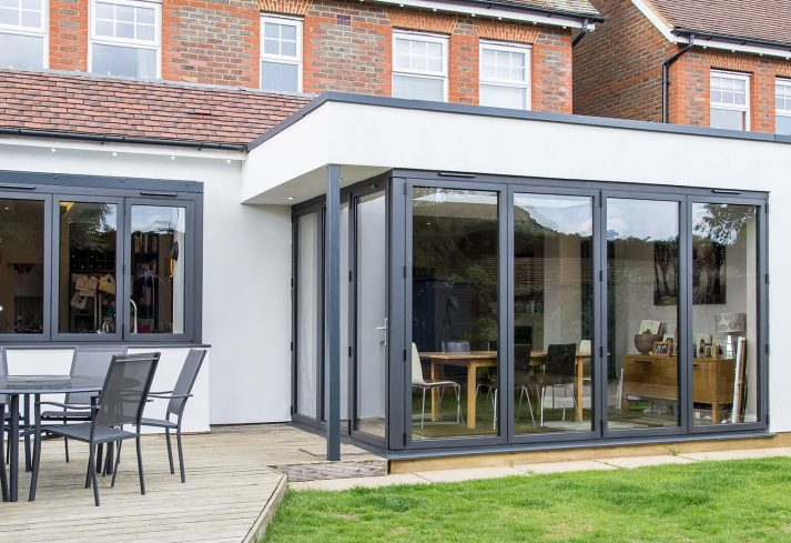 house extension and decking with garden furniture