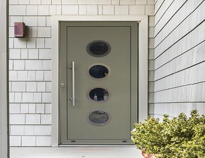front door with round windows and metal handle