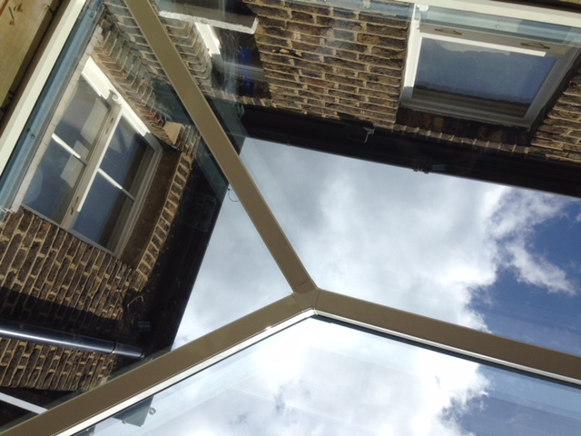 blue sky and clouds through a Rooflight