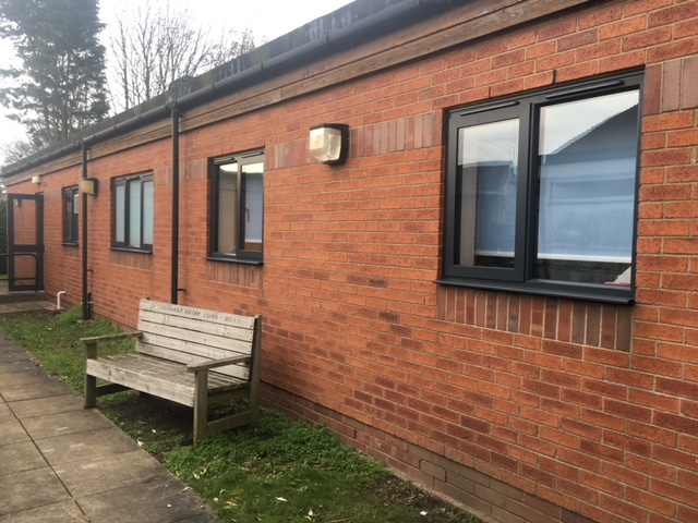 skegness outpatients department with wooden bench outside
