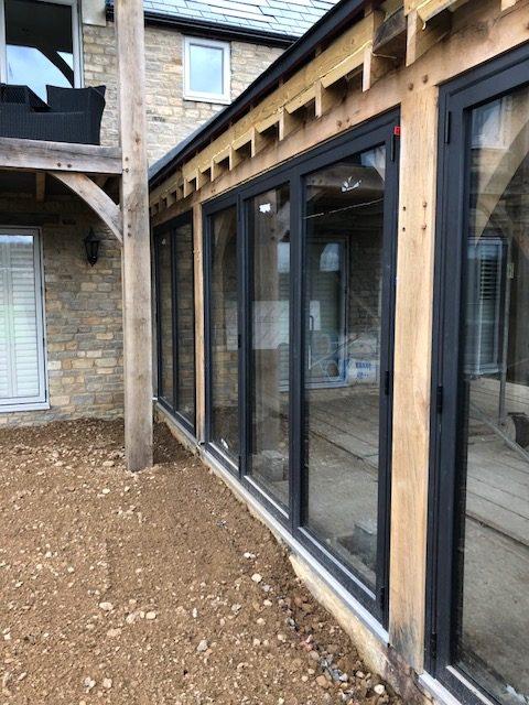 barn conversion site wooden beams and aluminium doors