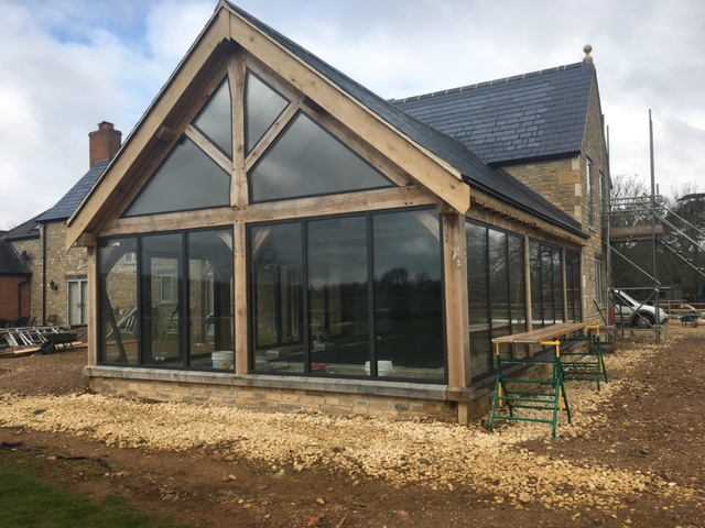 Barn conversion with glass and wood