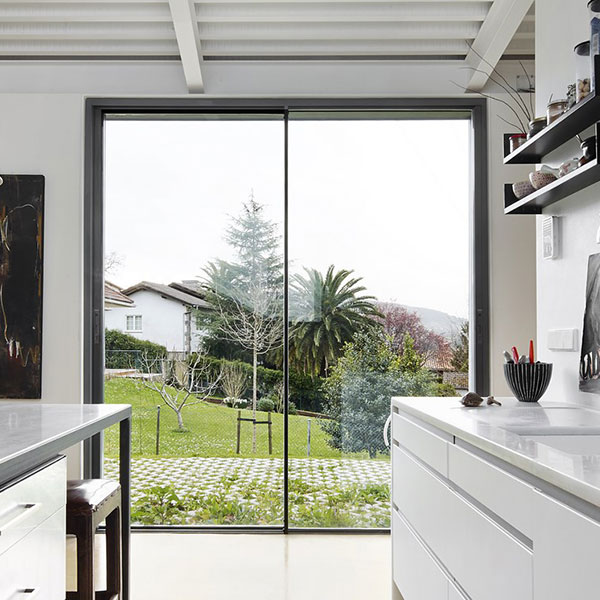 kitchen setting with views of grass and trees