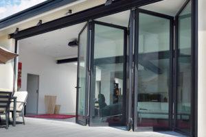 Aluminium Bi-fold Doors open onto patio area