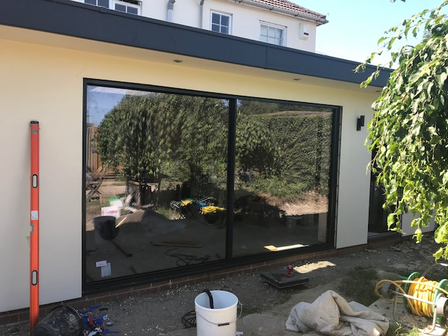 patio doors with spirit level, bucket and hose