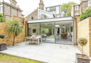 patio area with outdoor furniture with door leading into house
