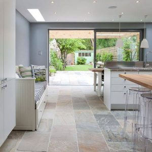 kitchen with seating and tiled flooring and views to patio garden area