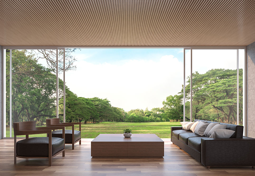 lounge area with sliding doors open to lawn and trees