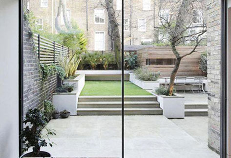 patio area with steps up to lawn and outdoor seating areas