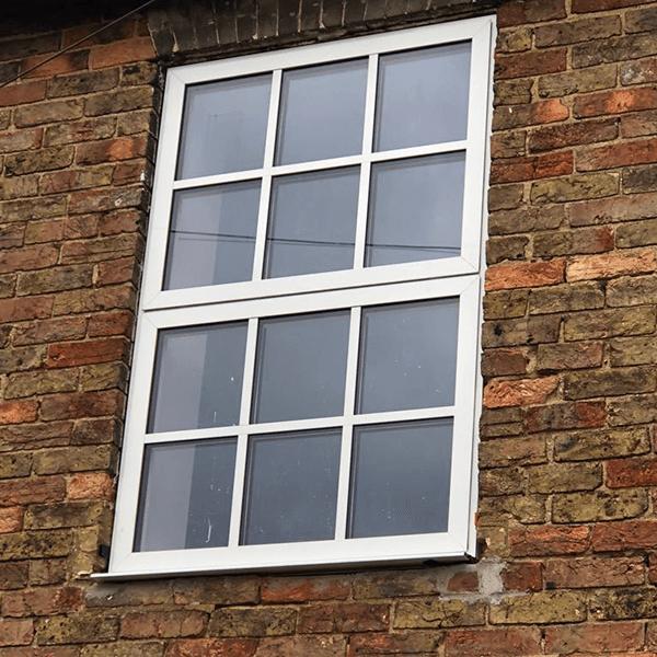 White Aluminium Windows in old brick wall