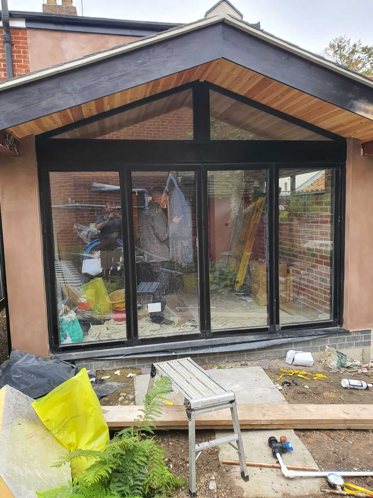 tradesmen at work inside house extension