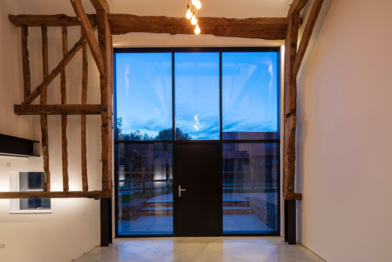 curtain wall with door and exposed wood beams