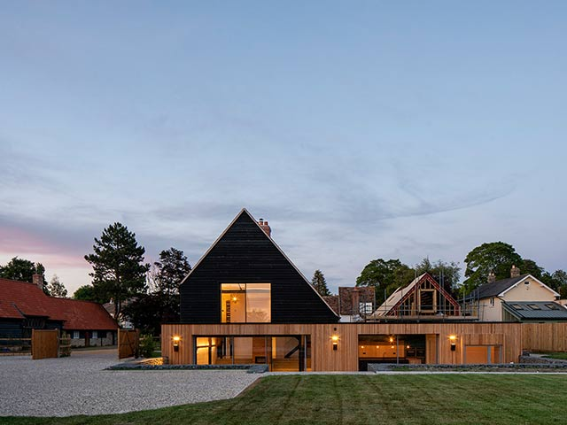 modern house with gravel drive and lawn