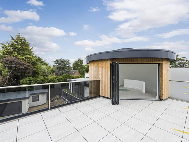 Roof terrace of modern house with trees behind