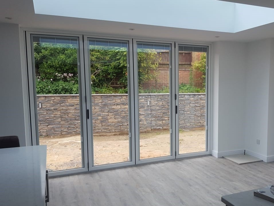 Patio doors and stone wall