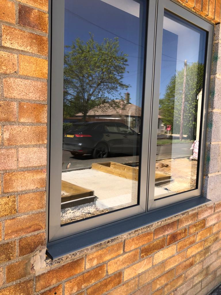 Aluminium Windows with car reflected in glass