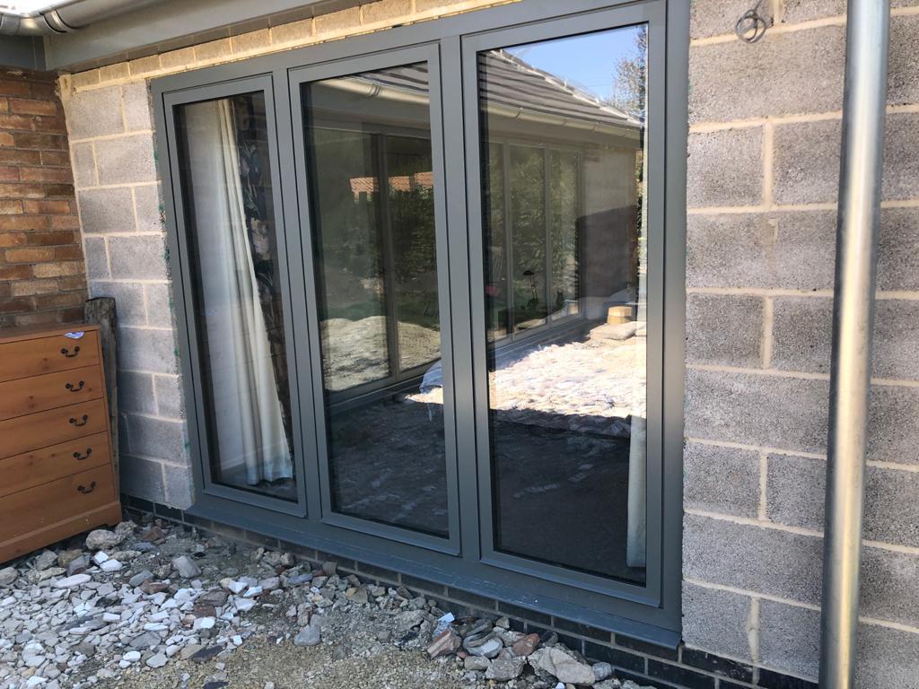 Aluminium doors fitted in breeze block wall
