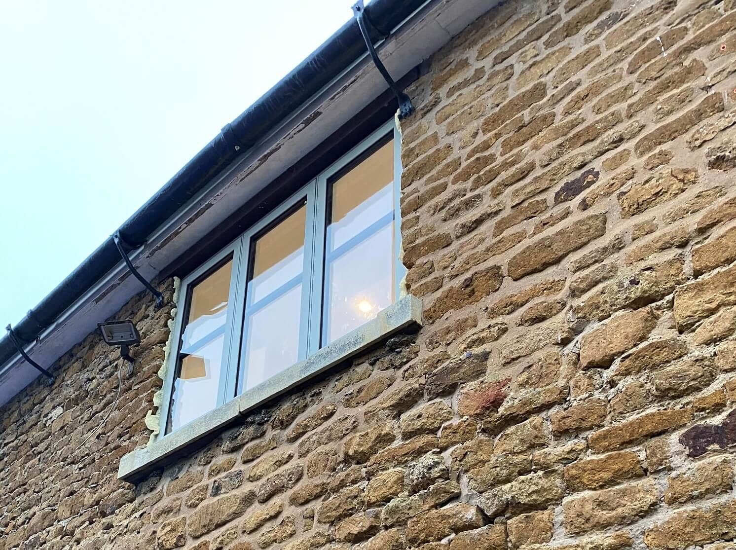 New upstairs window in an old brick wall