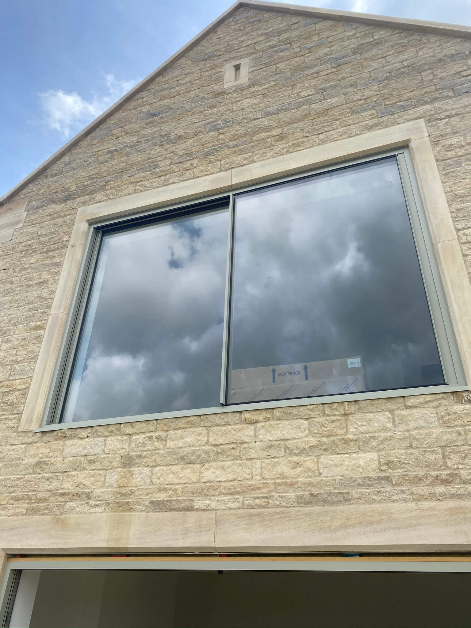 large window in natural stone house