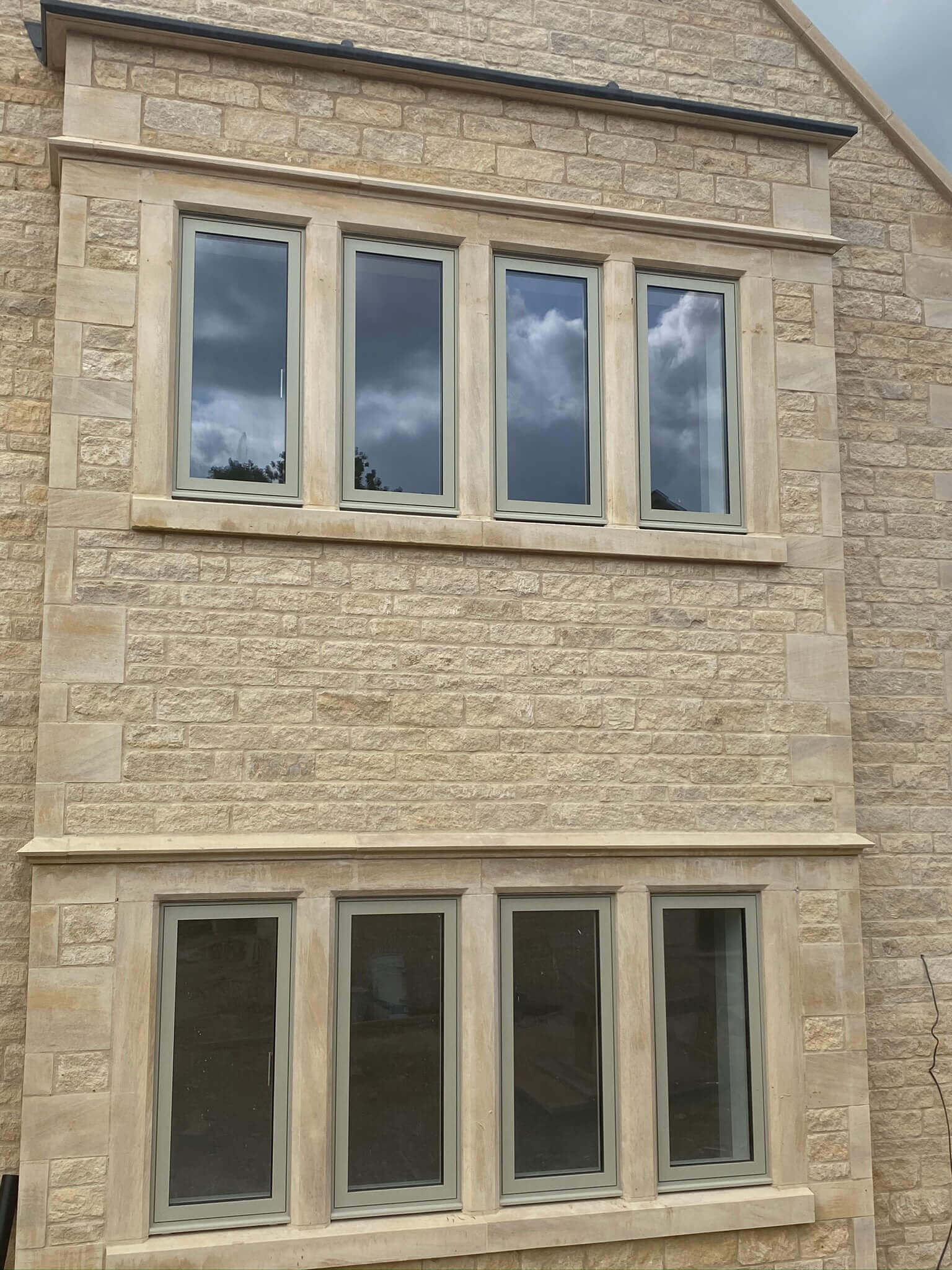 natural stone house with new windows