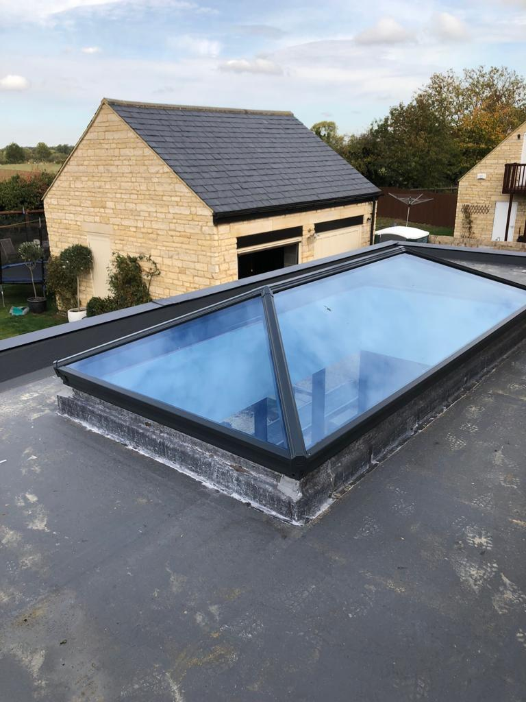 Roof lantern with garage to rear