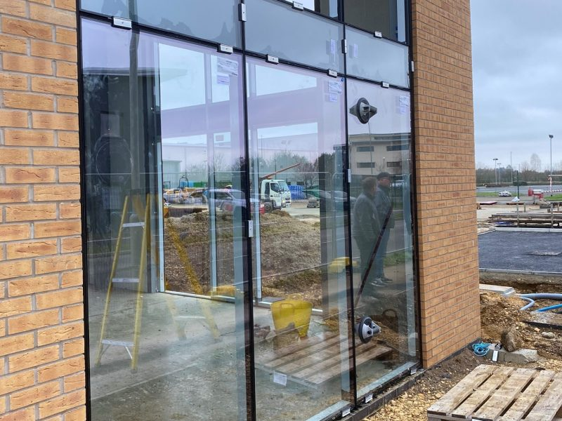 Aluminium curtain walling being installed at commercial building