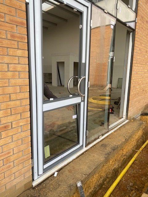 Installation of aluminium doors at commercial property