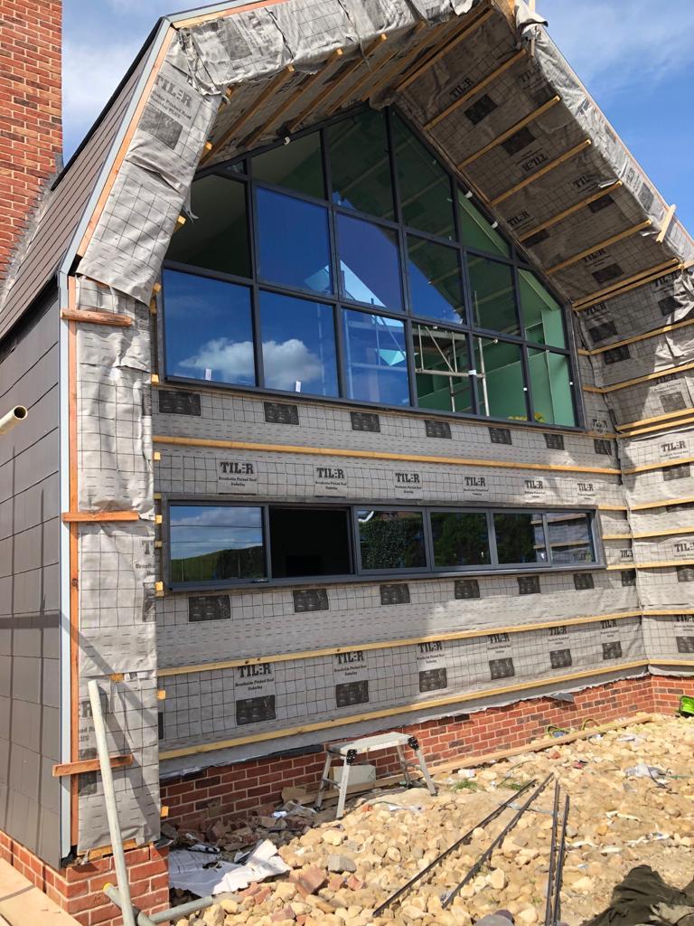window installation in progress Dutch barn new build