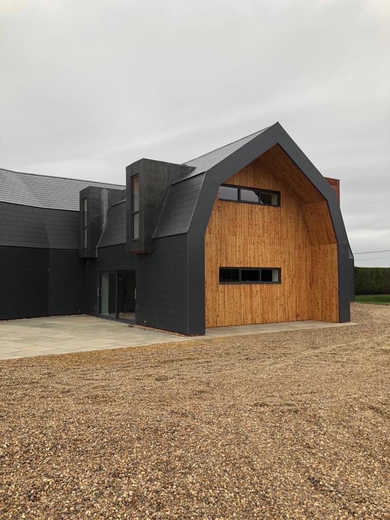 Sliding doors and slimline windows new build Dutch barn