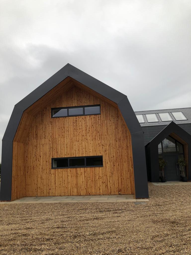 Aluminium slimline windows in Dutch barn new build