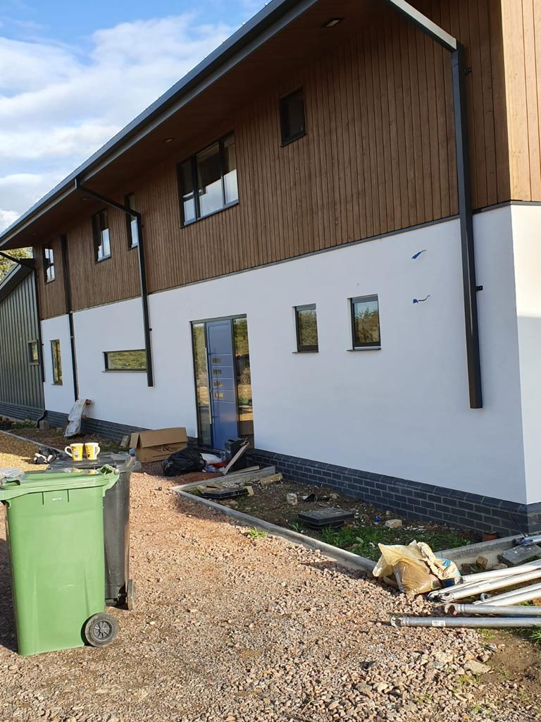 Rear view of new building windows and door