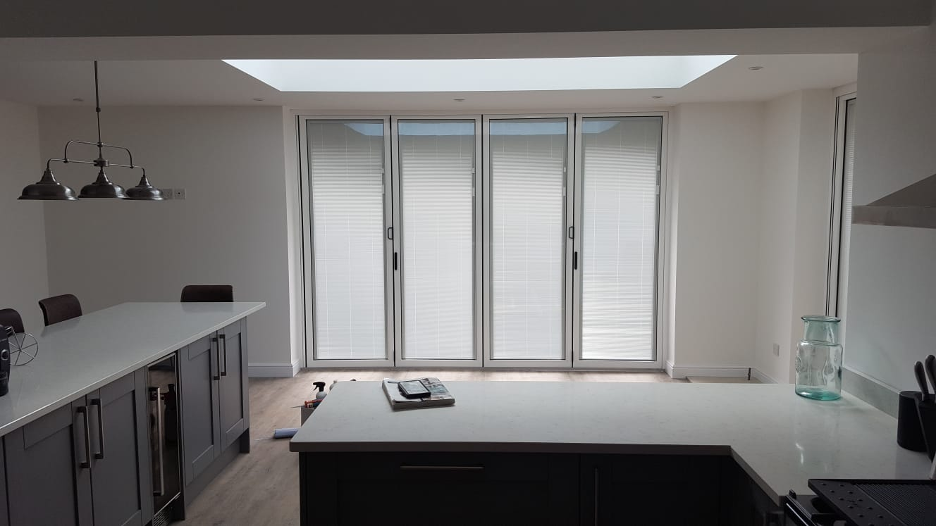 Internal view of patio doors and kitchen work surfaces